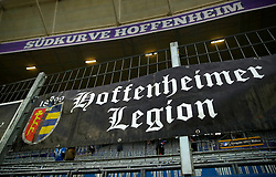 A Hoffenheimer Legion sign hangs in the stands