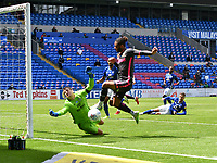 Football - 2019 / 2020 Sky Bet EFL Championship - Cardiff City vs. Leeds United<br /> <br /> Alexander Smithies of Cardiff City defends  Tyler Roberts of Leeds United on the attack, at Cardiff City Stadium.<br /> <br /> COLORSPORT/WINSTON BYNORTH