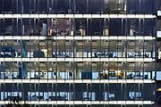 Nederland, Venlo, 4-12-2017 In een kantoorgebouw zijn mensen aan het werk. Foto: Flip Franssen