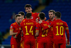 CARDIFF, WALES - Wednesday, November 18, 2020: Wales' Kieffer Moore (top) celebrates after scoring the third goal during the UEFA Nations League Group Stage League B Group 4 match between Wales and Finland at the Cardiff City Stadium. Wales won 3-1 and finished top of Group 4. (Pic by David Rawcliffe/Propaganda)