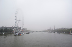 © London News Pictures. 22/10/2012. London, UK.  Fog covered Houses of Parliament  and London Eye in Westminster, central London on October 22, 2012 . Photo credit: Ben Cawthra/LNP