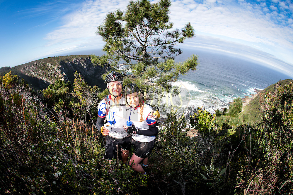 Bernhard Schmidt and Heidi Stumpf pose for a photo overlooking the Indian Ocean during day one of the Glacier Storms River Traverse mountain bike stage race held at the The Tsitsikamma Village Inn situated in Storms River Village on the Garden route, South Africa on the 6th August 2016<br /> <br /> Photo by:    / Dryland Event Management / SPORTZPICS<br /> <br /> <br /> {dem16gst}