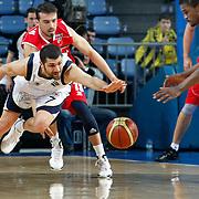 Fenerbahce Ulker's Omer ONAN (L) and Pinar Karsiyaka's Alper SARUHAN (B) during their Turkish Basketball league match Fenerbahce Ulker between Pinar Karsiyaka at Sinan Erdem Arena in Istanbul, Turkey, Saturday, April 09, 2011. Photo by TURKPIX