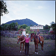 """Evening horseback riding at The Hermitage Plantation Inn, Nevis.  Views of the """"Manor House Villa"""" and Mt. Nevis in the background."""