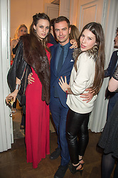 Left to right, LILY ROBINSON, ROBERT SHEFFIELD and LILY LEWIS at the Tatler Little Black Book Party at Home House Member's Club, Portman Square, London supported by CARAT on 11th November 2015.
