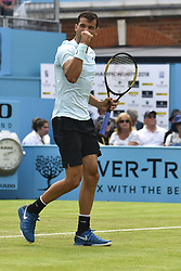 June 19, 2018 - London, England, United Kingdom - Bulgaria's Grigor Dimitrov reacts against Bosnia and Herzegovina's Damir Dzumhur during their first round men's singles match at the ATP Queen's Club Championships tennis tournament in west London on June 19, 2018. Dimitrov won the match 6-3, 7-6, 6-3. (Credit Image: © Alberto Pezzali/NurPhoto via ZUMA Press)