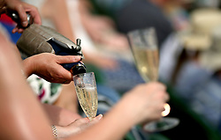 Spectators pour drinks on day eight of the Wimbledon Championships at the All England Lawn Tennis and Croquet Club, Wimbledon. PRESS ASSOCIATION Photo. Picture date: Tuesday July 10, 2018. See PA story TENNIS Wimbledon. Photo credit should read: Steven Paston/PA Wire. RESTRICTIONS: Editorial use only. No commercial use without prior written consent of the AELTC. Still image use only - no moving images to emulate broadcast. No superimposing or removal of sponsor/ad logos. Call +44 (0)1158 447447 for further information.