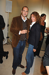 Presenter JOHNNY VAUGHAN and his wife ANTONIA at a party to launch jeweller Boodles new store at 178 New Bond Street, London W1 on 26th September 2007.<br />