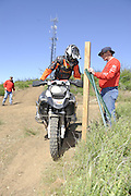 Rider holding leaning pole during day 1 compeition at 2010 Rawhyde Adventure Rider Challenge