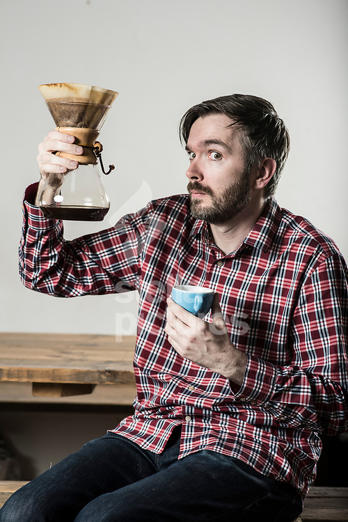 Comedy writer-perfomer and podcaster Tom Goodliffe pictured at Vagabond Cafe in north London. <br /> Goodliffe has a upcoming show in Edinburgh based on his love of coffee<br /> Picture by Daniel Hambury/Stella Pictures Ltd 07813022858<br /> 26/07/2017