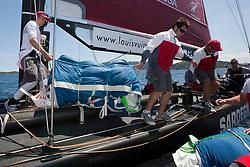 Crew transferring of the boat. Semi-final Artemis (SWE) vs Emirates Team New Zealand (NZL.  La Maddalena, Sardinia, June 4th 2010. Louis Vuitton Trophy  La Maddalena (22 May -6 June 2010) © Sander van der Borch / Artemis