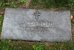 26 August 2017:   A part of the History of McLean County Illinois.<br /> <br /> Tombstones in Evergreen Memorial Cemetery.  Civic leaders, soldiers, and other prominent people are featured. Civil War Veterans Section.  Jacob Ford.