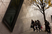 Young students walk past the exterior of the Daniel Libeskind designed London Metropolitan University's modern Graduate Centre. Hurrying on to their next lecture, young women and a male friend chat enthusiastically passing the polished surfaces. London Metropolitan University is one of the foremost providers of undergraduate, postgraduate, professional and vocational education and training in Britain. Their courses are planned in consultation with employers and examining bodies in commerce, industry, the world of art and design, the financial services industries and other professions. To compare profiles, Oxford University has the lowest proportion of working-class students, with 11.5%. London Metropolitan University has the greatest proportion, with 57.2%. The first building, designed by Charles Bell, was opened in 1896.