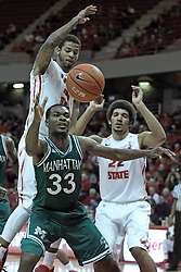 20 November 2013:  Donovan Kates guarded by Michael Middlebrooks and Reggie Lynch during an NCAA Non-Conference mens basketball game between theJaspers of Manhattan and the Illinois State Redbirds in Redbird Arena, Normal IL