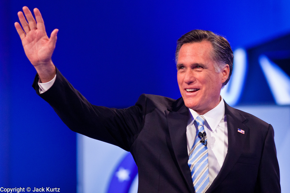 """22 FEBRUARY 2012 - MESA, AZ:   Governor MITT ROMNEY waves to the crowd at the Arizona Republican Presidential Debate in the Mesa Arts Center in Mesa, AZ, Wednesday. It is the last debate before the Michigan and Arizona Republican primaries on Feb. 28 and """"Super Tuesday"""" on March 6.         PHOTO BY JACK KURTZ"""