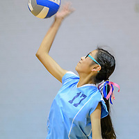 Window Rock Middle School Scout Mikaela Roanhorse serves to the St. Michael Indian School Cardinals at the Fort Defiance Field House Tuesday.