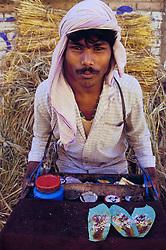 Asia, Nepal, Kathmandu Valley, Bhaktapur, man selling pan, mixture of betel nut and herbs