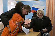 Znamenka, Russia, 02/03/2008..A grandmother helps her daughter and grand-daughter as Russians vote during the Presidential election that President Vladimir Putin's chosen heir Deputy Prime Minister Dmitry Medvedev is expected to win easily in the first round.