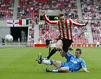 Fotball<br /> Foto: SBI/Digitalsport<br /> NORWAY ONLY<br /> <br /> Sunderland v Wigan Athletic<br /> Coca-Cola Championship<br /> Stadium of Light, Sunderland 28/08/2004<br /> <br /> Wigan's Ian Breckin (R) puts in a sliding challenge on Sunderland's Dean Whitehead (L).