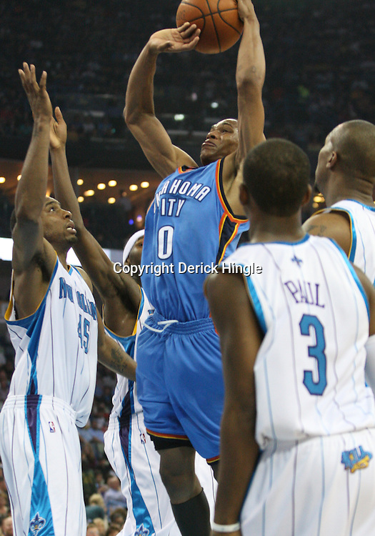 07 March 2009: Oklahoma City Thunder guard Russell Westbrook (0) shoots over Hornets defenders Rasual Butler (45), David West (30) and Chris Paul (3)during a NBA game between the New Orleans Hornets and the Oklahoma City Thunder at the New Orleans Arena in New Orleans, Louisiana.