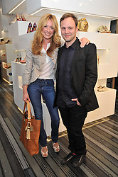 NICHOLAS KIRKWOOD and CAT DEELEY at the opening party for Nicholas Kirkwood's new store at 5 Mount Street, London on 12th May 2011.