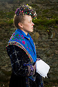Lisa-Marie is wearing an original traditional bridal costume in Waldsolms-Kraftsolms, Hesse in Germany on March 5th, 2017.<br /> <br /> This is the traditional costume of the Hüttenbergerlandes. The bridesmaid is wearing part of the bridal crown from 1880. The dress is from around 1920.<br /> <br /> This is part of the series about Traditional Wedding Gowns from different regions of Germany, worn by young members of local dance groups and cultural associations that exist to preserve and celebrate the cultural heritage. The portraiture series is a depiction of an old era with different social values and religious beliefs in an antiquated civil society with very few of those dresses left.
