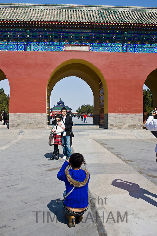 Tourists pose for a photograph at gate, Temple of Heaven, Beijing, China