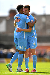 Coventry City's Jordan Willis (left) and Chris Stokes celebrate at the final whistle