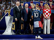 FIFA President Gianni Infantino, Russia President Vladimir Putin, France President Emmanuel Macron hugs Kylian Mbappe, Croatia President Kolinda Grabar-Kitarovic during the trophies ceremony after the 2018 FIFA World Cup Russia, final football match between France and Croatia on July 15, 2018 at Luzhniki Stadium in Moscow, Russia - Photo Thiago Bernardes / FramePhoto / ProSportsImages / DPPI