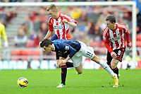 Football - 2012 / 2013 Premier League - Sunderland vs. Tottenham Hotspur<br /> Gareth Bale (Spurs) goes down after being tackled from Craig Gardner (Sunderland) at the Stadium of Light