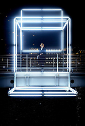 Actress Julia Ford stands within the cube installation at the Canary Wharf winter lights festival, as sculptures, structures and installations are presented in different forms of light technology.