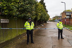 Police cordons surround the scene where a man was shot dead and another wounded near Queensbury Tube Station in North West London. London, May 02 2018.
