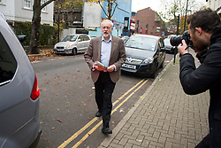 © Licensed to London News Pictures. 11/11/2015. London, UK. Labour Party leader JEREMY CORBYN leaving his home in Islington, north London carrying a newspaper on the day that he is due to be sworn in to Privy Council by Queen Elizabeth II. It is not known if Corbyn, who is a republican, will kneel in front of the Queen,  normally a requirement as part of a swearing-in ceremony for the group that advises monarchs.  Photo credit: Ben Cawthra/LNP