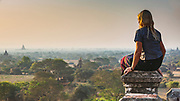 Travellers eye view. Watching the sun rise over the temples of Bagan is a magical experience, with several thousand temples from the 11th to 13th century spread over about 30-40 square kilometres of plains at a bend in the Irrawaddy river in the centre of Burma / Myanmar
