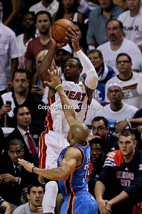 Jun 21, 2012; Miami, FL, USA; Miami Heat shooting guard Dwyane Wade (3) shoots over Oklahoma City Thunder point guard Derek Fisher (37) during the third quarter in game five in the 2012 NBA Finals at the American Airlines Arena. Mandatory Credit: Derick E. Hingle-US PRESSWIRE