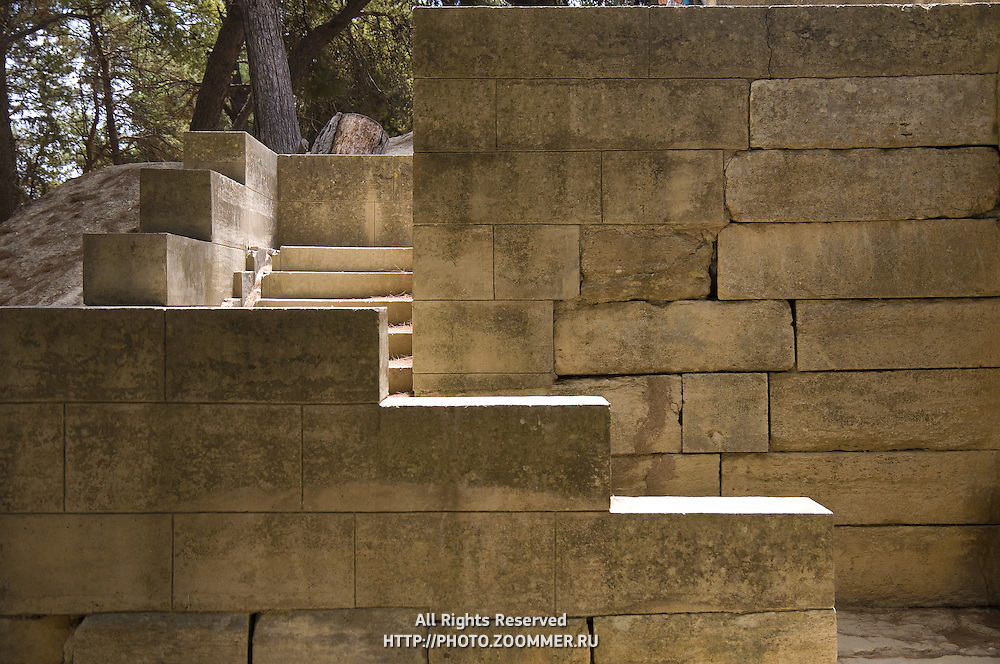 Ancient stonewalls and steps of the minoan palace at Knossos