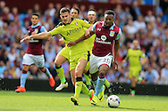 Adama of Aston Villa ® , holds off Dominic Ball of Rotherham Utd.EFL Skybet championship match, Aston Villa v Rotherham Utd at Villa Park in Birmingham, The Midlands on Saturday 13th August 2016.<br /> pic by Andrew Orchard, Andrew Orchard sports photography.