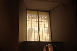 Window in basement apartment. Mystery fantasy intrigue CITY URBAN STOCK PHOTO