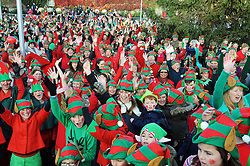 © Licensed to London News Pictures. 22/11/2013<br /> Elves celebrating world record.<br /> It was all about the Elf and Safety today (22.11.2013) at Gravesend Community Square,Gravesend in Kent as 948 elves arrived to break the world record for the highest number of elves in one place.  The event is part of Graveshams council Twelve Days of Christmas festival.The event was filmed by Guinness World records.<br /> Photo credit :LNP