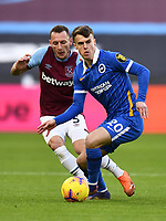 Football - 2020 / 2021 Premier League - West Ham United vs Brighton & Hove Albion - London Stadium<br /> <br /> Brighton & Hove Albion's Solly March \holds off the challenge from West Ham United's Vladimir Coufal.<br /> <br /> COLORSPORT/ASHLEY WESTERN