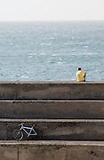 Enjoying the view of the Atlantic Ocean from the harbour of El Cotillo, Fuerteventura, Spain.