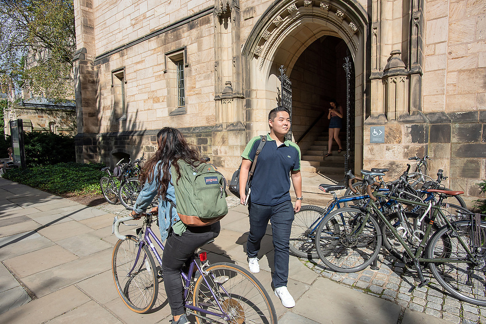 Photography ©Mara Lavitt<br /> October 10, 2018<br /> Yale University campus, New Haven<br /> <br /> Yale undergraduate student TanTan Wang exits Harkness Hall.