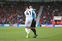 Football - 2019 / 2020 Premier League - AFC Bournemouth vs. West Ham United<br /> <br /> Declan Rice of West Ham United hugs Referee Mr Stuart Attwell after celebrating Aaron Cresswell's equaliser at the Vitality Stadium (Dean Court) Bournemouth <br /> <br /> COLORSPORT/SHAUN BOGGUST