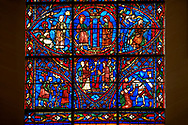 Medieval Windows of the Gothic Cathedral of Chartres, France, dedicated to the life of the Virgin Mary.  Bottom Left pruning of the vines, right Count Thibault VI. The top centre oval panel shows Anna and Joachim meet at the Golden Gate, below The high priest refuses the offerings of Joachim, left Annunciation to Joachim , right Annunciation to Anna . A UNESCO World Heritage Site. .<br /> <br /> Visit our MEDIEVAL ART PHOTO COLLECTIONS for more   photos  to download or buy as prints https://funkystock.photoshelter.com/gallery-collection/Medieval-Middle-Ages-Art-Artefacts-Antiquities-Pictures-Images-of/C0000YpKXiAHnG2k