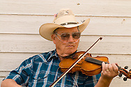 Fiddler with portable oxygen concentrator, Montana Old Time Fiddlers Picnic, Livingston Montana