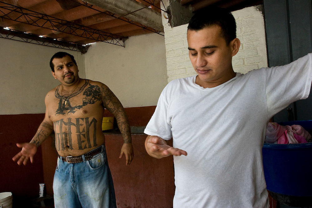 Diego (left) speaks with other members of his 18th street clique in San Salvador.  Diego followed his parents to the states when he was 10, like many  families they were fleeing the war in the 1980's.  Soon after arriving in the states Diego joined the rapidly growing 18th street gang, and by the time he was 20 he found himself in jail for attempted murder. He was deported in 2000 and currently lives in a house paid for by his parents in the United States. In and out of prison he struggles to find employment and move on from his current life in the gang.