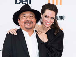"""Director and Actress Angelina Jolie, right, and Rithy Panh react on the red carpet for the movie """"First They Killed My Father"""" during the 2017 Toronto International Film Festival in Toronto, ON, Canada, on Monday, September 11, 2017. Photo by Nathan Denette/CP/ABACAPRESS.COM"""