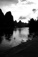 Man bathes in the Li River at sunset, Yangshuo, Guanxi, China, Asia