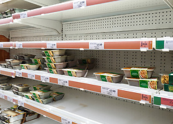 © Licensed to London News Pictures. 04/10/2021. London, UK. Nearly empty shelves of pre-cooked meat products in Sainsbury's, north London, amid fears of food shortages over Christmas. The Government and retailers warn that food and fuel shortages could continue until Christmas due to labour shortages following Brexit. According to Iceland, sales of frozen turkeys are up by more than 400 per cent compared to this time last year. Photo credit: Dinendra Haria/LNP