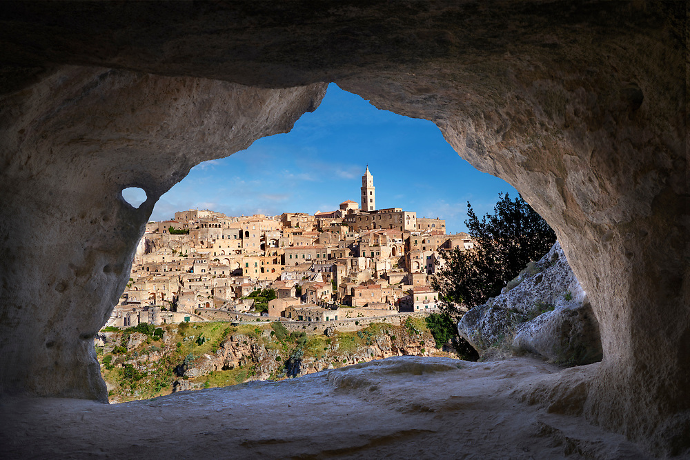 """Matera view across """"la Gravina"""" ravine to the Sassi of Matera from inside a Sassi cave, Basilicata, Italy. A UNESCO World Heritage site. .<br /> <br /> Visit our ROMAN ART & HISTORIC SITES PHOTO COLLECTIONS for more photos to download or buy as wall art prints https://funkystock.photoshelter.com/gallery-collection/The-Romans-Art-Artefacts-Antiquities-Historic-Sites-Pictures-Images/C0000r2uLJJo9_s0<br /> .<br /> <br /> Visit our MEDIEVAL PHOTO COLLECTIONS for more   photos  to download or buy as prints https://funkystock.photoshelter.com/gallery-collection/Medieval-Middle-Ages-Historic-Places-Arcaeological-Sites-Pictures-Images-of/C0000B5ZA54_WD0s"""